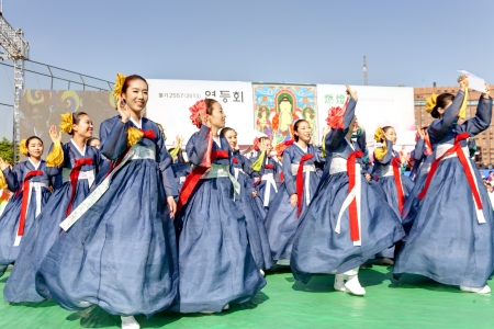 korean culture: Seoul, South Korea - May 11, 2013: Young people wearing traditional clothes are performing at Buddhist Cheer Rally for celebration of Lotus Lantern Festival, Dongguk University Stadium, Seoul, South Korea. Buddha's birthday is a major event on the Korea