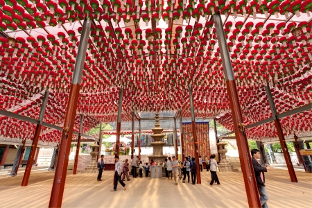 lotus lantern: Seoul, South Korea - May 11, 2013: A lot of red lanterns are hanging for celebration of Lotus Lantern Festival in the Bongeun-sa Temple which is a 1200 year old temple located in Samseong-dong, Gangnam-gu, Seoul, South Korea. Some people are visting the t