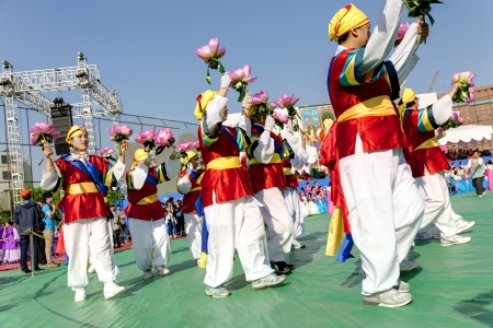 Seoul, South Korea - May 11, 2013: People wearing traditional clothes are performing at Buddhist Cheer Rally for celebration of Lotus Lantern Festival, Dongguk University Stadium, Seoul, South Korea. Buddha's birthday is a major event on the Korean cale