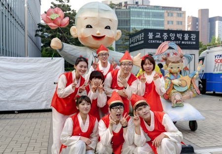 lotus lantern: Seoul, South Korea - May 12,2013, Young people in traditional clothes are taking pictures before participating Culture Performances for celebration of Lotus Lantern Festival at Insa-dong, Seoul, South Korea. Buddha's birthday is a major event on the Kor Editorial