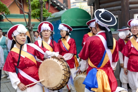 south asian ethnicity: Seoul, South Korea - May 12, 2013: Some senior Korean people wearing traditional clothes are performing dances before participating Culture Performances for celebration of Lotus Lantern Festival at Jogyesa Temple, Seoul, South Korea. Buddha's birthday i