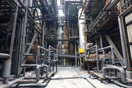 abandoned factory: interior of steel mill with pipes and valves
