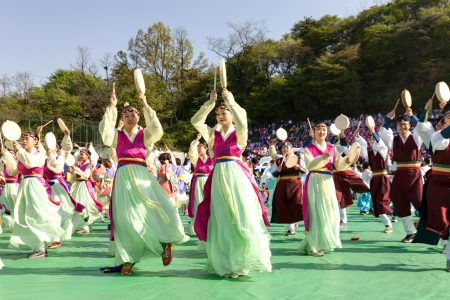 Seoul, South Korea - May 11, 2013: Actresses are performing at Buddhist Cheer Rally for celebration of Lotus Lantern Festival, Dongguk University Stadium, Seoul, South Korea. Buddha?s birthday is a major event on the Korean calendar and the Lotus Lantern