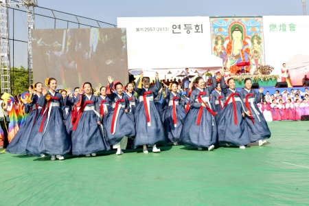 lotus lantern: Seoul, South Korea - May 11, 2013  Young people wearing traditional clothes are performing at Buddhist Cheer Rally for celebration of Lotus Lantern Festival, Dongguk University Stadium, Seoul, South Korea  Buddha's birthday is a major event on the Korea