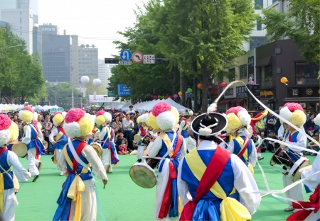 Seoul, South Korea - May 12, 2013  People wearing traditional clothes are performing folk dance for celebration of Lotus Lantern Festival on the street in front of Jogyesa Temple, Seoul, South Korea  Buddhas birthday s a major event on the Korean calenda