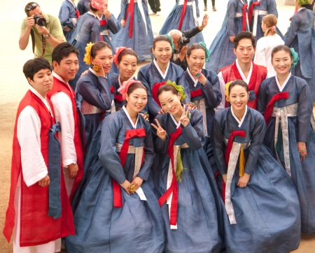 lotus lantern: Seoul, South Korea - May 12, 2013  Young people wearing traditional clothes are taking pictures before participating Culture Performances for celebration of Lotus Lantern Festival at Jogyesa Temple, Seoul, South Korea  Buddhas birthday is a major event o