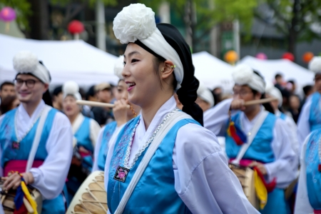 Seoul, South Korea - May 12, 2013  People wearing traditional clothes are performing folk dance for celebration of Lotus Lantern Festival on the street in front of Jogyesa Temple, Seoul, South Korea  Buddha's birthday s a major event on the Korean calen