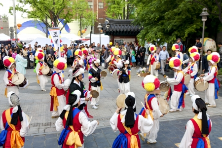 lotus lantern: Seoul, South Korea - May 12, 2013  People wearing traditional clothes are performing folk dance for celebration of Lotus Lantern Festival on the street in front of Jogyesa Temple, Seoul, South Korea  Buddha's birthday s a major event on the Korean calen