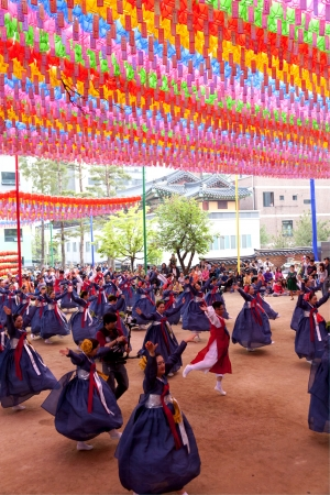 lotus lantern: Seoul, South Korea - May 12, 2013  Young people wearing traditional clothes are performing folk dance for celebration of Lotus Lantern Festival on the street in front of Jogyesa Temple, Seoul, South Korea  Buddha's birthday s a major event on the Korean