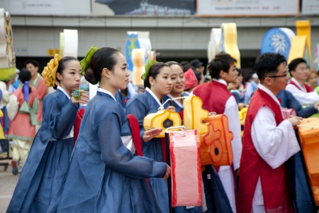 Seoul, South Korea - May 12, 2013  Young people wearing traditional clothes participate Culture Performances for celebration of Lotus Lantern Festival at Jogyesa Temple, Seoul, South Korea  Buddha's birthday is a major event on the Korean calendar and t