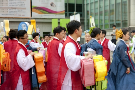 lotus lantern: Seoul, South Korea - May 12, 2013  Young people wearing traditional clothes participate Culture Performances for celebration of Lotus Lantern Festival at Jogyesa Temple, Seoul, South Korea  Buddha's birthday is a major event on the Korean calendar and t