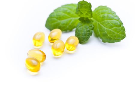 naturopath: vitamin capsules with mint leaf  Stock Photo