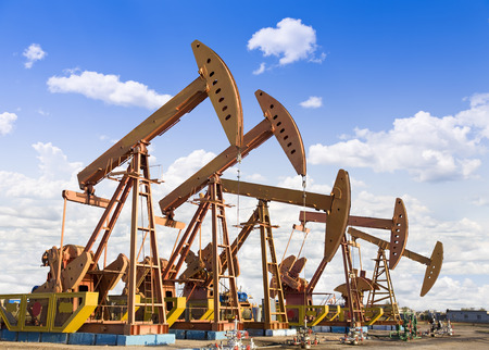 oil exploration: oil pump jacks working at dawn.