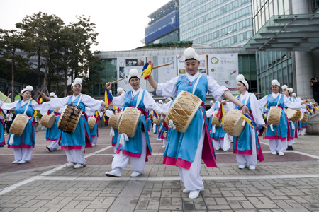 lotus lantern: Seoul, South Korea - May 12, 2013: People wearing traditional clothes are performing folk dance for celebration of Lotus Lantern Festival on the street in front of Jogyesa Temple, Seoul, South Korea. Buddha�s birthday s a major event on the Korean calenda Editorial