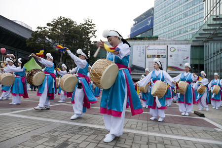 Seoul, South Korea - May 12, 2013: People wearing traditional clothes are performing folk dance for celebration of Lotus Lantern Festival on the street in front of Jogyesa Temple, Seoul, South Korea. Buddha�s birthday s a major event on the Korean calenda