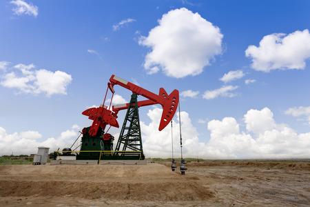 jacks: Working oil pump jacks on a oil field Stock Photo