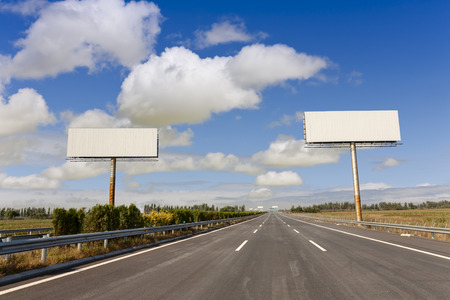 two blank billboards by the highway