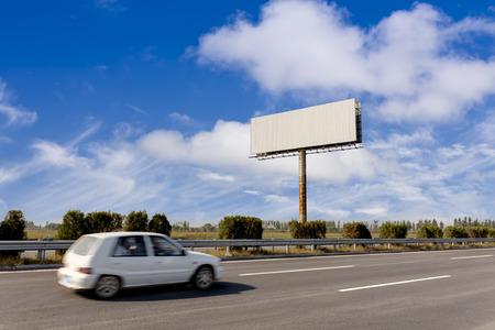 Blank billboard and blurred vehicle photo