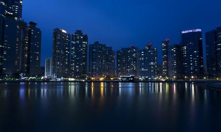 Night view of modern buildings, Haeundae in Busan, South Korea. 免版税图像