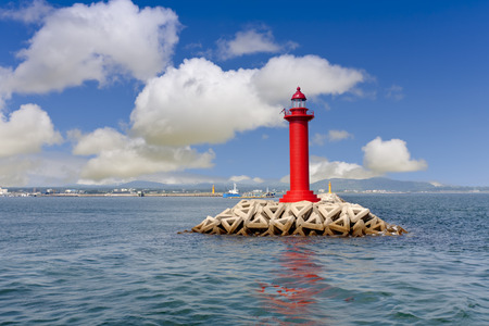 lighthouse keeper: red lighthouse and clear sky Stock Photo