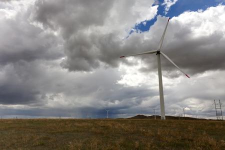 wind turbines and cloudy sky photo