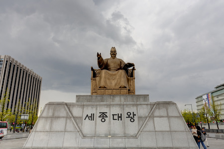 Seoul, Korea - May 01, 2013: Tourists walking around King Sejong statue, the fourth king of the Joseon Dynasty of Korea at Gyeongbokgung Palace, Seoul, South Korea on May 01, 2013.