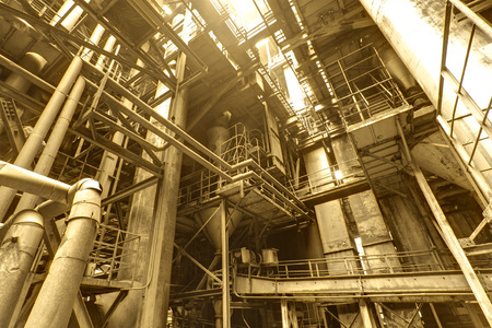 Interior of steel mill with pipes and valves 免版税图像