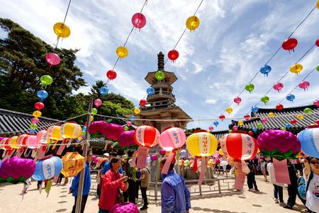 Gyeongju, South Korea - May 17, 2013: People are visiting the Bulguksa Temple where hanging lanterns for celebrating the Buddhas birthday, Gyeongiu, South Korea. Buddha's birthday is major event on the Lunar calendar in Korea. Editorial