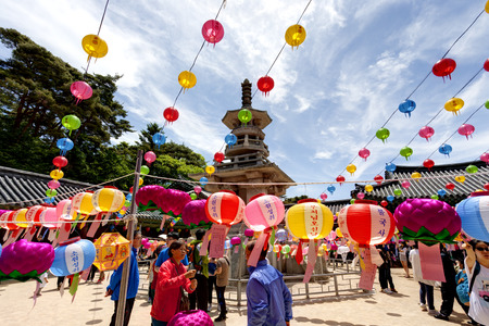 Gyeongju, South Korea - May 17, 2013: People are visiting the Bulguksa Temple where hanging lanterns for celebrating the Buddhas birthday, Gyeongiu, South Korea. Buddhas birthday is major event on the Lunar calendar in Korea.