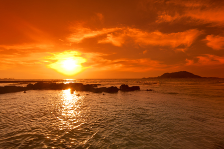 Sunset seascape and volcano, Jeju island, Korea.