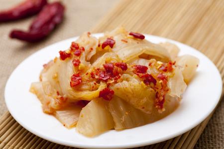 Spicy Korean kimchee on plate 免版税图像