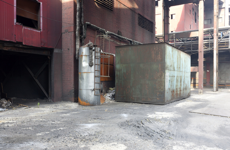 An abandoned steel mill with old machine.
