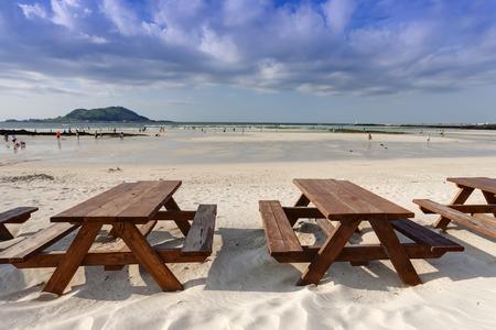 Empty wooden table on the beach, Jeju Island, South Korea