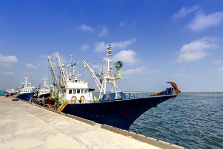 fishing boats docked at harbor