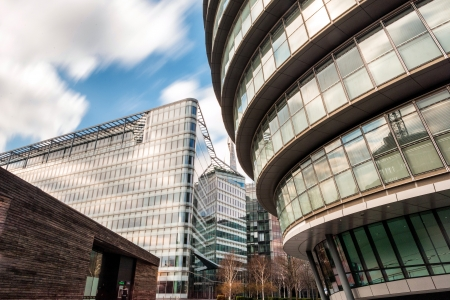 Building around London City Hall on April 6, 2013 in London, UK  The City hall building has an unusual, bulbous shape, intended to improve energy efficiency Stock Photo - 19487928