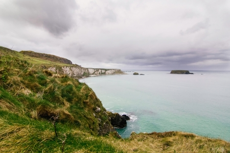 Cliff around Carrick-a-Rede, Northern Island photo