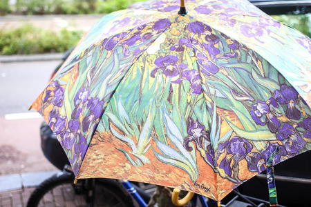 van gogh: Umbrella with printed Van Gogh artwork displayed outside the Van Gogh Museum in Amsterdam, Netherlands
