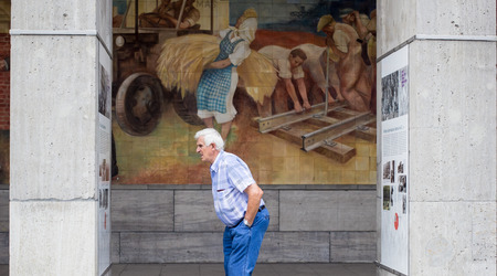 An old man reading the facts on Old Luftwaffe Headquarters, Berlin, Germany