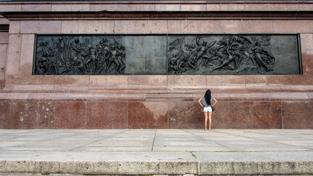 A women looking at the sculpture on the Victory Column located at the Tiergarten in Berlin, Germany
