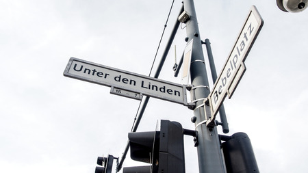 Road signage showing direction to Unter den Linden and Bebelplatz in Berlin, Germany