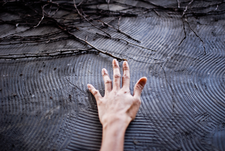 Hand on textured wall