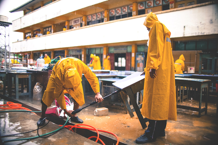 Volunteers cleaning the school that affected by flood disaster in Tanah Merah, Kelantan, Malaysia Editorial