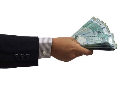Hand of businessman giving money with isolated background
