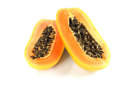 cutaneous: Papaya fruit sliced on half over white background. Stock Photo