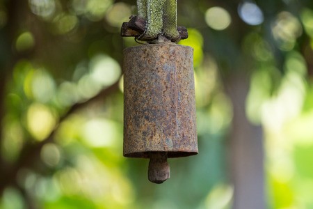 Close up of old rusty bells, tools for farm animals.