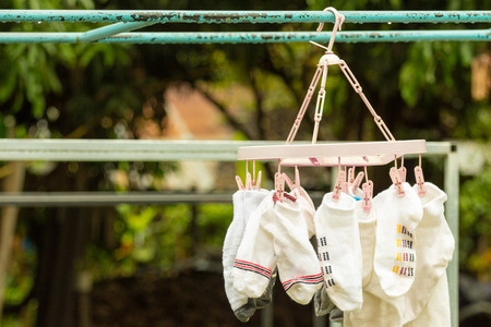 Socks hung to dry on a clothes line. Stock Photo