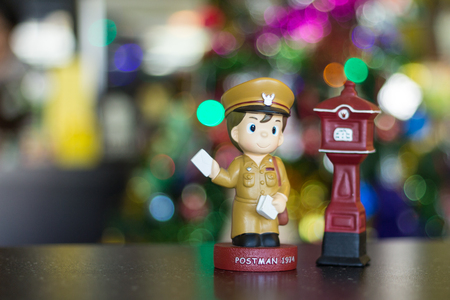 Focus Model doll postman and Thai post box. Stock Photo