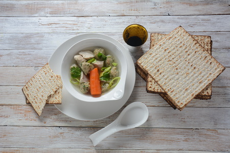 Chicken Matzo ball soup with carrots in the bowl. Jewish traditional Passover holiday food Stock Photo