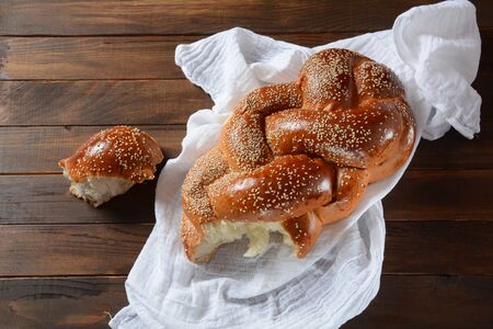 Homemade challah bread with sesame seeds. Jewish traditional bread for Shabbat