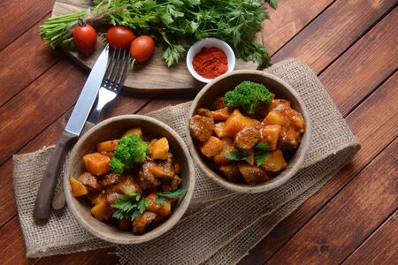 Traditional homemade Hungarian beef meat stew, Goulash with potatoes, carrots , tomatoes, broccoli in a bowl Фото со стока